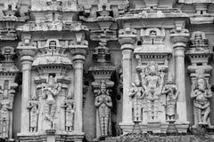 Hampi Sculptures. Sculptures of Krishna (playing flute), Vishnu, and Ganesha on the tower (gopuram) of the Virupaksha temple at Hampi Stock Photography