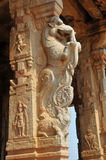 Hampi temple columns. Hindu temple columns with a fine sculpted Yarzis (dragon) ... and deities Stock Images