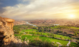 Hampi valley in India. View to Rice plantations and river from the top of Hanuman monkey temple on the hill in Hampi, Karnataka, India stock image