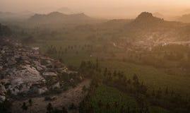 Hampi view from matanga hill at sunrise over the achyutaraya temple india karnakata mystical. Sky royalty free stock photo