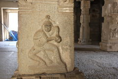 Hampi Vittala Temple Pillar Carving of Clown or Jester Royalty Free Stock Photos
