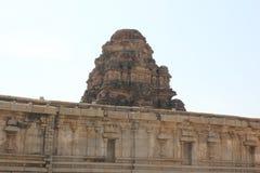 Hampi Vittala Temple top structure and walls with carvings. This is the Hampi Vittala Temple top structure and walls with carvings, which is in  Karnataka, India Royalty Free Stock Photos