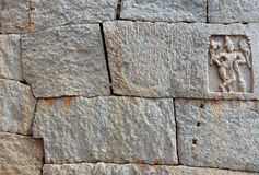 Hampi wall. Temple wall with fitted blocks of granite ... Shiva carved in one of them ... mason marks visible ( Hampi, India Stock Images