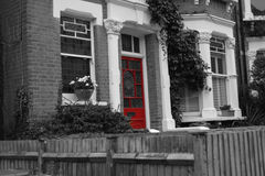 Hampsted red door reddoor home house flat entry entrance exit red color Stock Photo