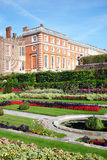 Hampton Court palace. In Surrey, England, UK, the home of Henry VIII, with its landscaped Privy Garden in the foreground Stock Image