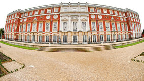 Hampton Court Palace. The rear entrance to Hampton Court Palace facing the Privvy Garden. The image was taken with a fisheye lens to give this unusual Royalty Free Stock Images
