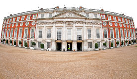 Hampton Court Palace. A side entrance into Hampton Court Palace. The image was taken with a fisheye lens to give this unusual perspective Royalty Free Stock Photo