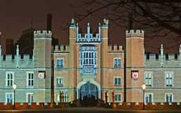 Hampton Court Palace at night. The front entrance to Hampton Court Palace at night Royalty Free Stock Images
