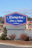 Hampton Inn And Suites Hotel Sign. DARTMOUTH, CANADA - JANUARY 21, 2015: Hampton Inn is currently the largest franchise in the United States. Trademarked by stock photos