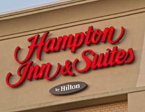 Hampton Inn & Suites Sign. DARTMOUTH, CANADA - JULY 10, 2017: Hampton Inn is currently the largest franchise in the United States. Trademarked by Hilton, the stock image