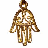 Hamsa. Hand, a common symbol in the mediterranean and middle east to ward off the evil eye; gold isolated on white Royalty Free Stock Image