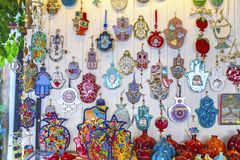 Hamsa amulets. Middle-eastern good luck charm. Decorations of Israeli and jewish culture royalty free stock photography