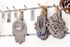 Hamsa amulets. Middle-eastern good luck charm. Decorations of Israeli and jewish culture stock image