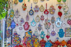 Hamsa amulets. Tel Aviv, Israel - June 10, 2018: Hamsa amulets, middle-eastern good luck charm. Decorations of Israeli and jewish culture sold at a little shop stock images