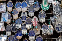 Hamsa with Chai symbol - Living sale at Carmel Market, popular marketplace in Tel-Aviv. Israel stock photography