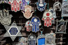 Hamsa with Chai symbol - Living sale at Carmel Market, popular marketplace in Tel-Aviv. Israel stock images