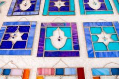 Hamsa and David Star stained glass plates sold at handicraft market. Tel-Aviv. Israel royalty free stock images
