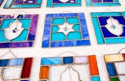 Hamsa and David Star stained glass plates sold at handicraft market. Tel-Aviv. Israel stock photos