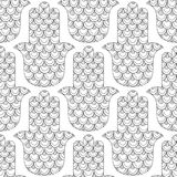 Hamsa hand. Black and white seamless pattern for coloring page. Decorative amulet for good luck and prosperity. Stock Photo