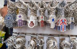 Hamsa keychains with Chai symbol - Living sale at Carmel Market, popular marketplace in Tel-Aviv. Israel stock images