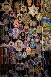 The hamsa and magen David, Arab market in Old City of Jerusalem. The Hamsa - palm-shaped amulet and Magen David - star of David, souvenirs in gift shop on Arab Stock Images