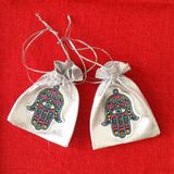 Hamsa. Two bags with hamsa symbol on red background royalty free stock images
