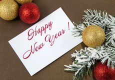 Hamster on the background of New Year`s decorations. With a greeting card Royalty Free Stock Photography