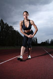 Hamstring Stretch Female Athlete On Running Track Stock Images