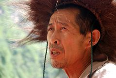 Han chinese man with traditional hat. Portrait of a Han chinese man with the  traditional hat  of the fishermen at yangtze river   made of nature  material Stock Photography