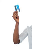 Han holding out debit card, cropped image Stock Image