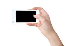 Han que sostiene un teléfono en cuanto a un selfie Foto de archivo libre de regalías