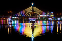 Han River Bridge in Danang. Han River Bridge in the city of Danang illuminated by colorful lights and crossing the Han River. In the middle of the night traffic royalty free stock photos
