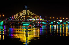 Han River Bridge in Danang. Han River Bridge in the city of Danang illuminated by colorful lights and crossing the Han River. In the middle of the night traffic royalty free stock photography