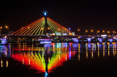 Han River Bridge Illumination. Illumination on Han River Bridge in Danang. The bridge crosses the Han River but in the middle of the night it swings on its axis stock images