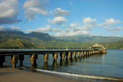 Hanalei Pier, Kauai. Early morning at Hanalei Pier on beautiful Hanalei Bay, captured on the island of Kauai in Hawaii Royalty Free Stock Image