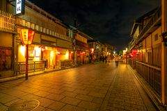 Hanamachi district night. Kyoto, Japan - April 24, 2017: people walking around Gion district by night with typical Kaiseki restaurant.Hanamachi is a Japanese Stock Photo