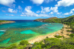 Hanauma Bay aerial view. Aerial view of famous Hanauma Bay Nature Preserve with beach and coral reef in Oahu island, Hawaii, United States. Summer time leisure Stock Image