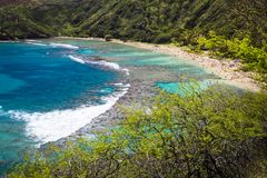 Hanauma Bay, Oahu, Hawaii. Snorkelling at the coral reef of Hanauma Bay, a former volcanic crater, now a national reserve Royalty Free Stock Photos