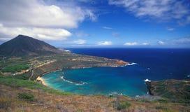 Hanauma Bay Panoramic. A panoramic high view of Hanauma Bay and surrounding hill, fields, shoreline and horizon on Oahu Stock Images