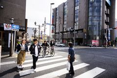 Hanazakicho zone, Narita Metro Station, Japanese people are crossing the crossroads. Urban people have strict discipline to use th. CHIBA JAPAN - MARCH 26, 2018 Stock Images