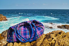 Hanbag on the reef by sea Stock Photography