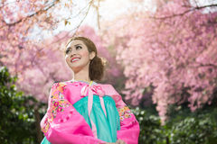 Hanbok: the traditional Korean dress and beautiful Asian girl wi. Th sakura Stock Images