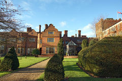 Hanbury Manor. Hotel in Ware UK, showing the beautiful garden, trees and pathway out back, a grand building Royalty Free Stock Images