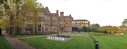 Hanbury Manor. A panoramic shot of the grand Hanbury Manor and gardens with golf course and a chess board Stock Photo
