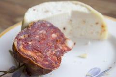 Hancraft primosale cheese and soppressata. Handcraft primosale cheese and calabresian soppressata salami stock image
