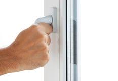 Hand öffnet ein Fenster Stockfotos