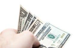 Hand över dollaranmärkningar Fotografering för Bildbyråer