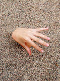 Hand 07. Open hand and fingers over sand Royalty Free Stock Photography