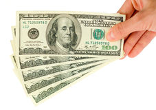 Hand with $100 banknotes stack. Isolated on white Stock Photography