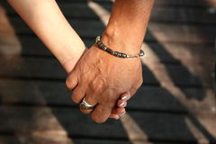 For a hand. Man and female hand photographed by the close up Stock Photos